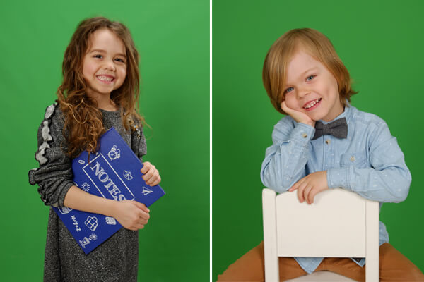 Girl posing with a note book and a boy seating on a chair