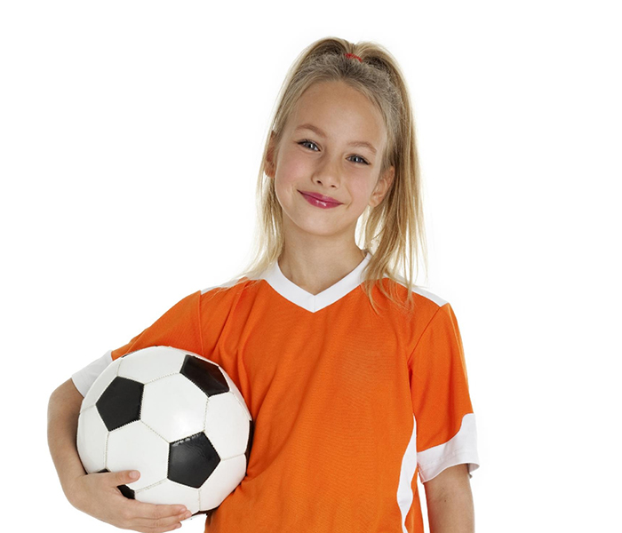 White Screen Image of a girl holding a soccer ball wearing an orange jersey